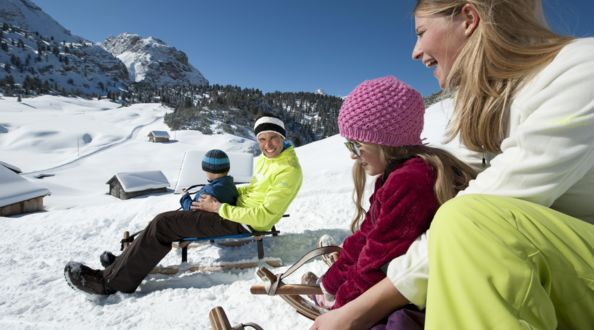 toboggan families, holiday in South Tyrol, winter Italy